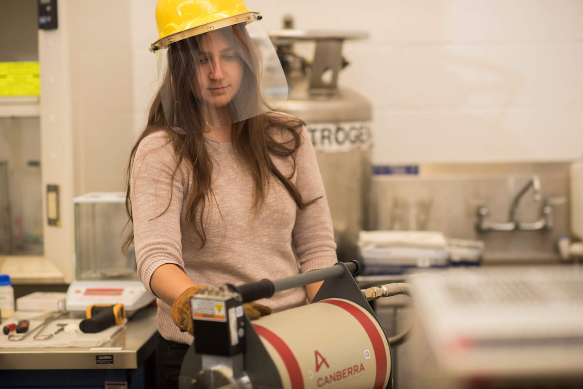 Grad student Ari Foley works in the radiation detection technologies and applications lab