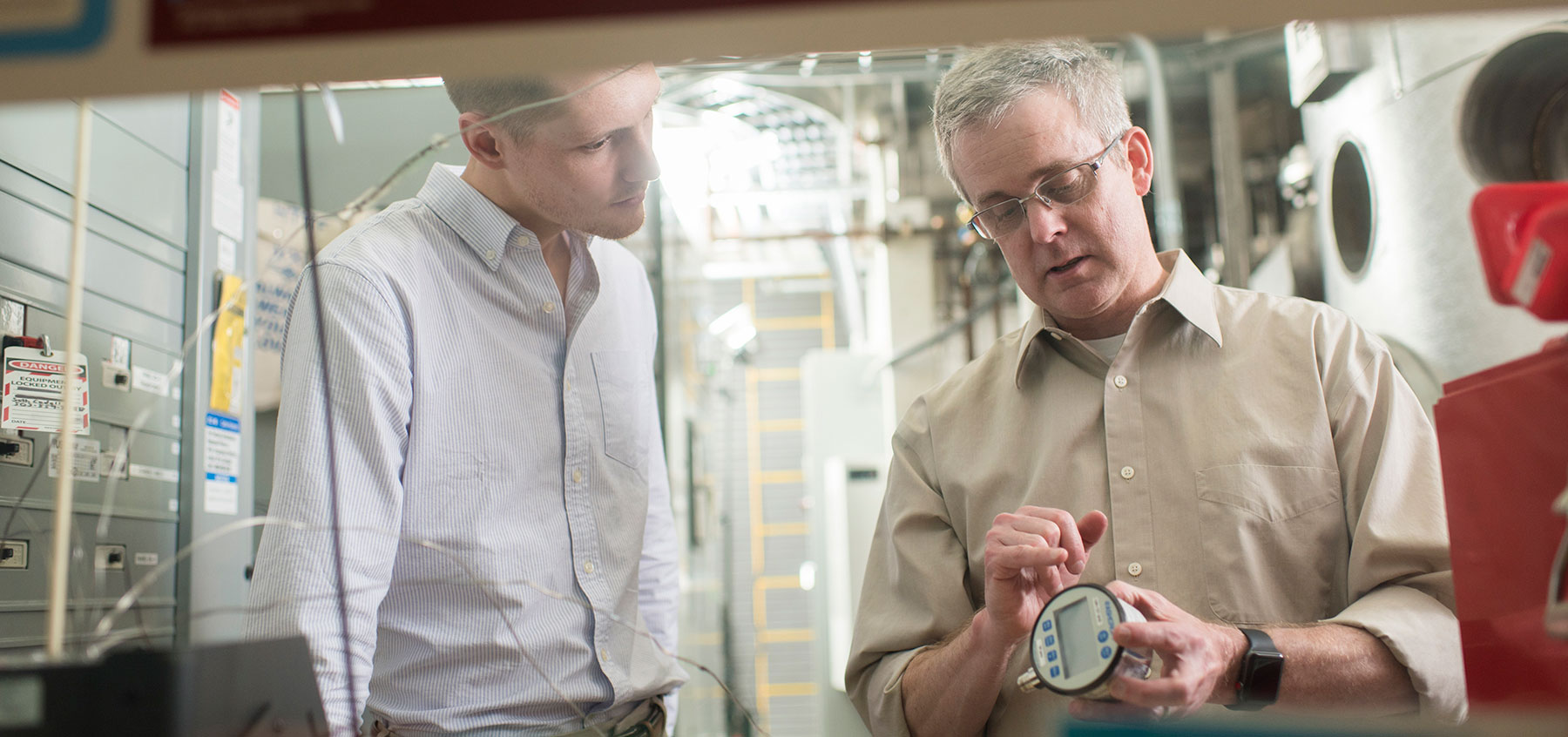 Brian Woods (right) is the Henry W. and Janice J. Schuette Chair in Nuclear Engineering and Radiation Health Physics.