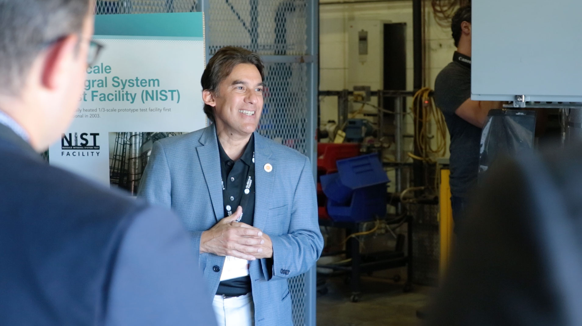 Professor Jose Reyes leads a tour of the NIST-1 facility.