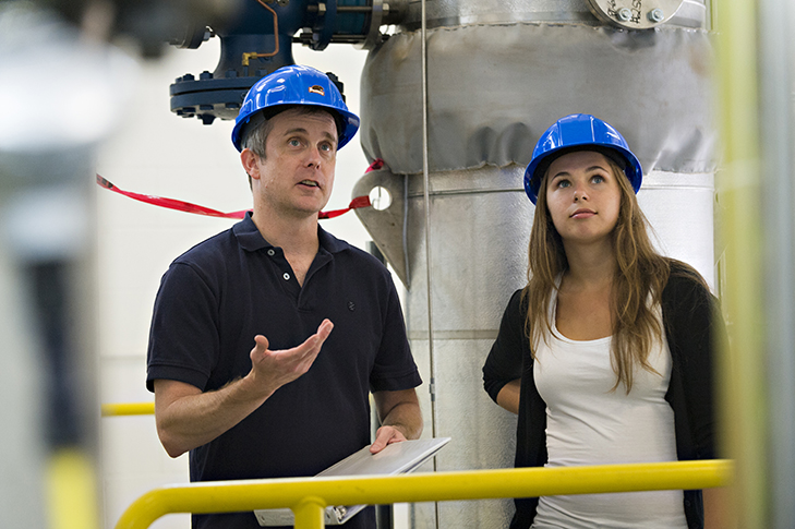 Professor Brian Woods and Ph.D. student Malwina Gradecka work on the High-Temperature Test Facility